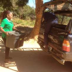 Mirriam loading the car with supplies to take to the children.